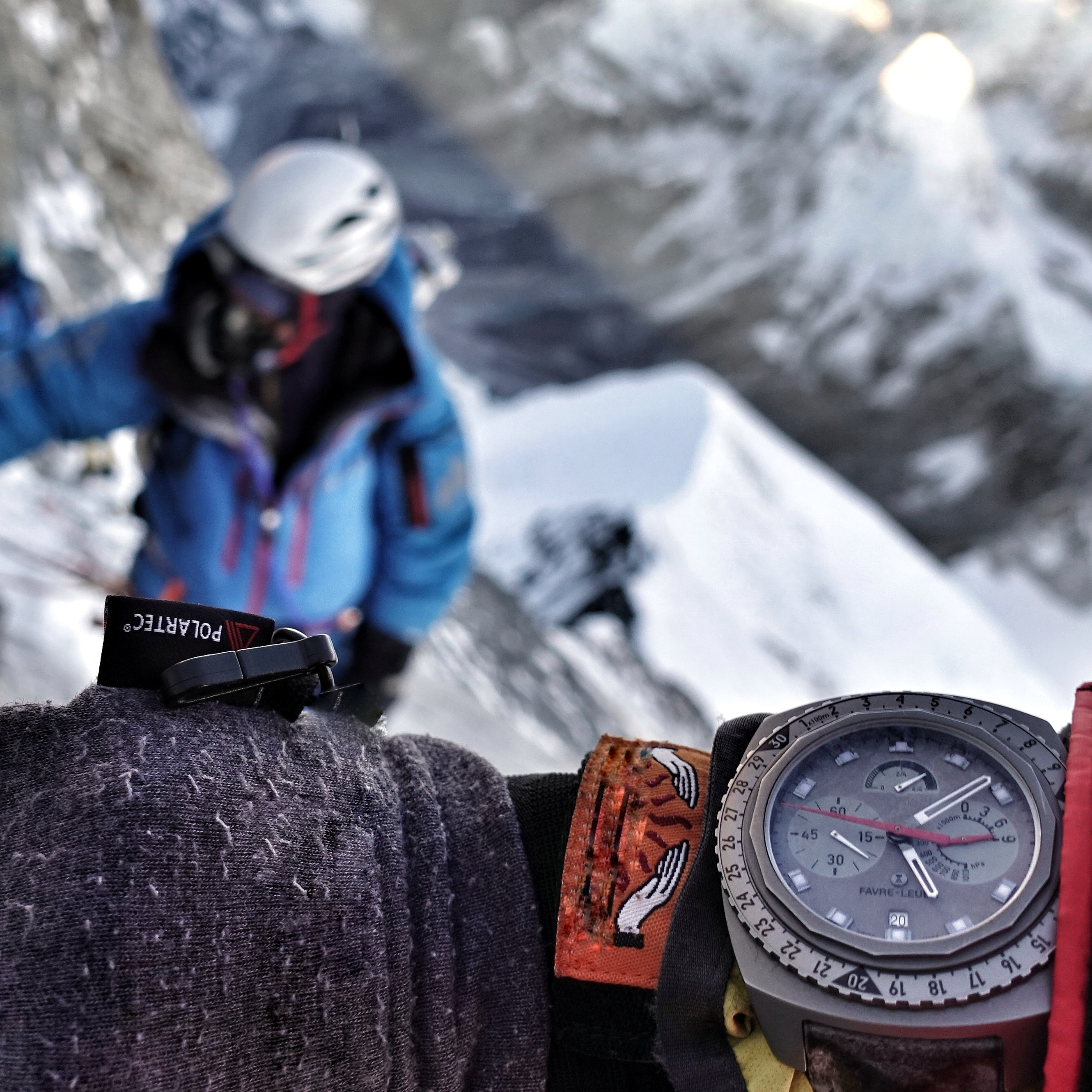 Raider Bivouac 9000 on Adrian Ballingers wrist while summiting Mt. Everest