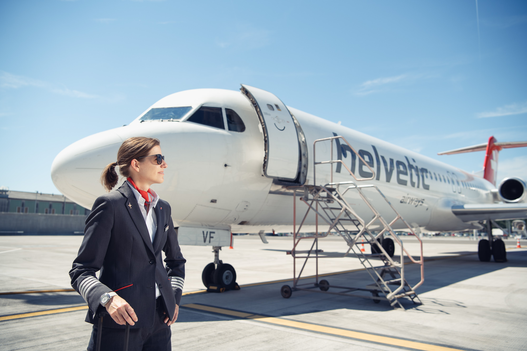 Swiss pilot Nadine Hachen in front of Helvetic Airways plane in Zurich airport